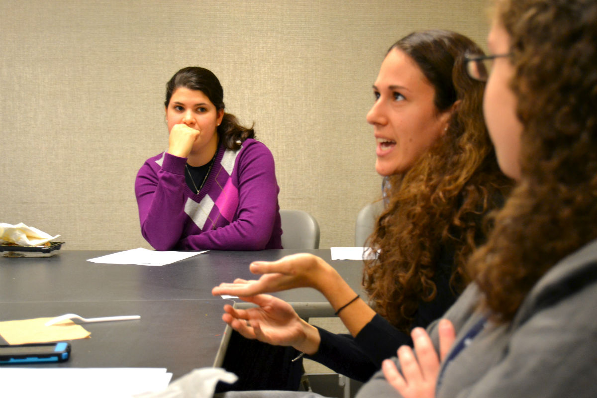 Students weigh in on a topic at Lander College for Women\'s extracurricular Torah Learning Club.