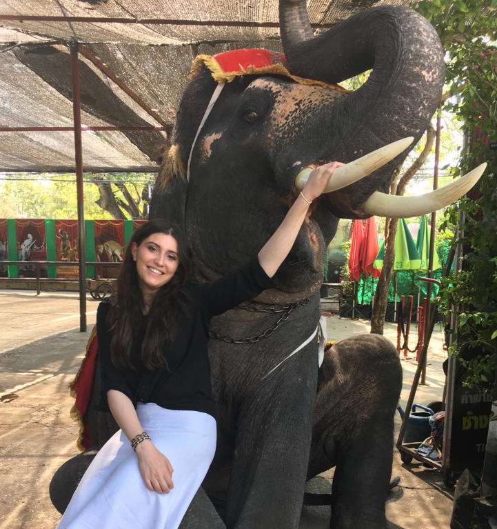 Shanie Sebbag posing with an elephant in Thailand