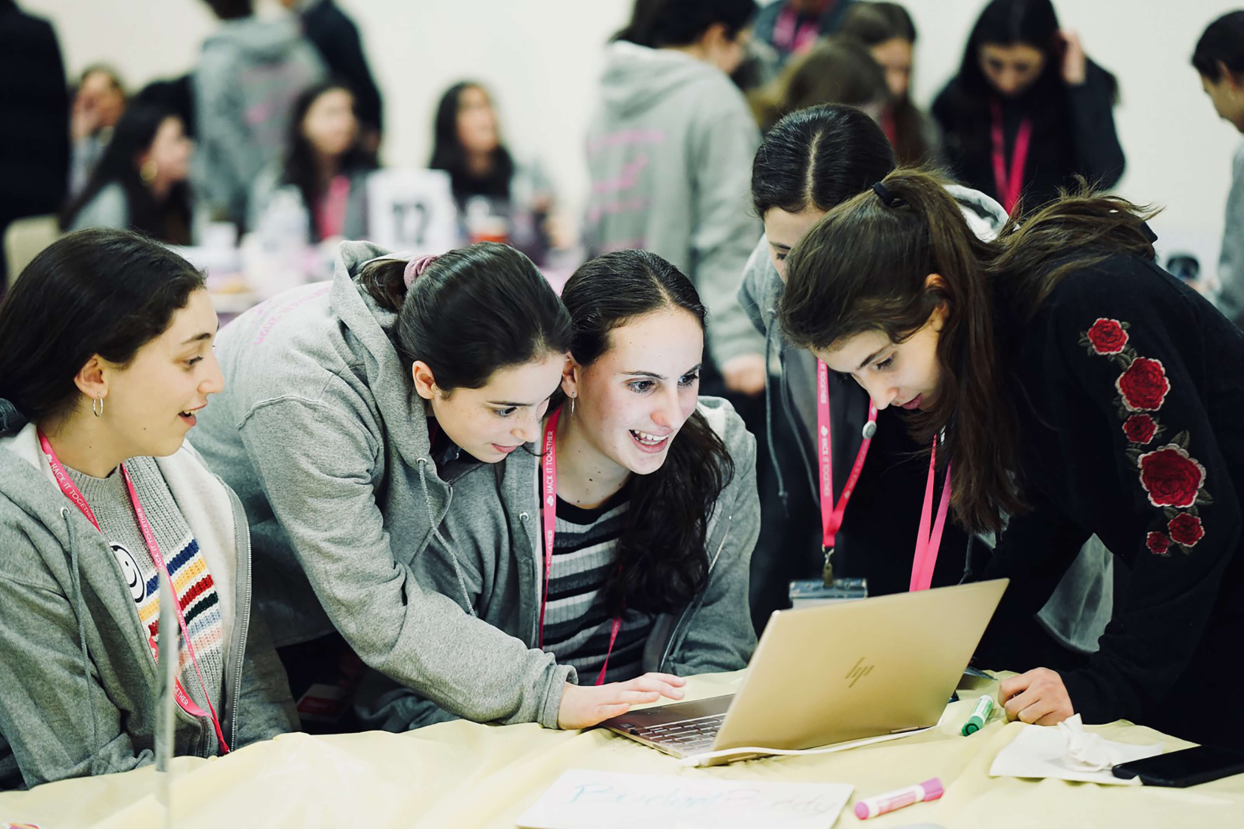 Hackers at LCW\'s 5th annual hackathon team up to plan their project